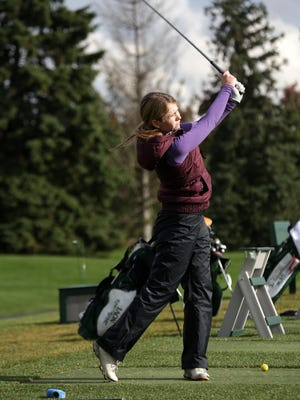 Claire Kalina plays for Novi and participates in practice at Walnut Creek Country Club golf course in South Lyon on Oct. 15, 2014.
