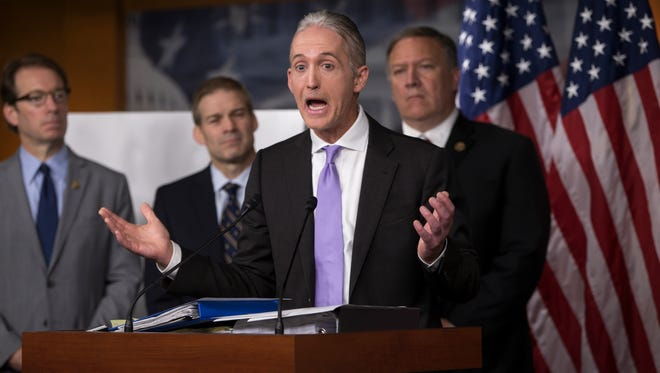 House Benghazi Committee Chairman Rep. Trey Gowdy, R-S.C., second from right, joined by other Republican members of the panel, discusses the release of his final report on the 2012 attacks on the U.S. consulate in Benghazi, Libya, during a news conference Tuesday on Capitol Hill.