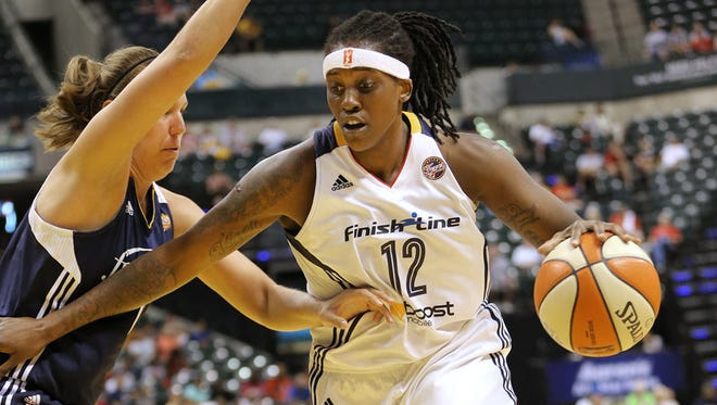 FILE -- Indiana Fever forward Lynetta Kizer drives to the hoop around Connecticut forward Kayla Pedersen in the first half of the game at Bankers Life Fieldhouse on Sunday, August 2, 2015. The Fever defeated Connecticut 83-70.