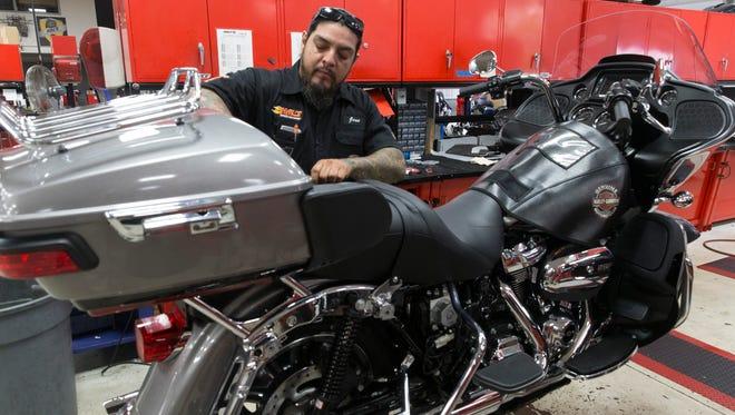 Jose Garza, a service technician at Hal's Harley-Davidson, prepares a bike for the Milwaukee Rally last fall.