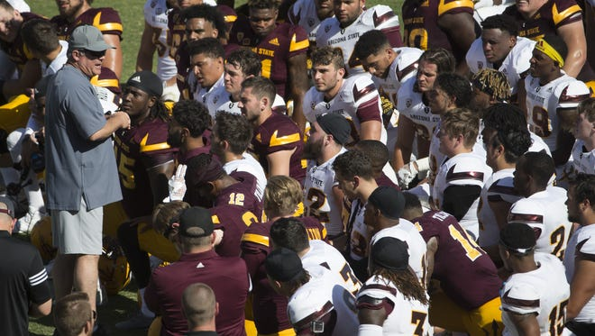 ASU's head coach Todd Graham speaks to his team after the Spring Game at Sun Devil Stadium in Tempe, Ariz. on April 15, 2017.