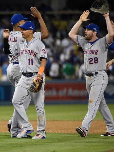 New York Mets shortstop Ruben Tejada (11) and second