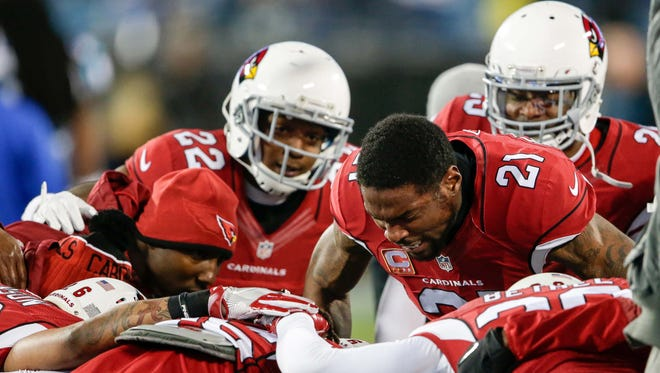 Jan 24, 2016: Arizona Cardinals cornerback Patrick Peterson (21) gets his teammates fired up before the start of the game against the Carolina Panthers during the NFC Championship football game held at Bank of America Stadium.