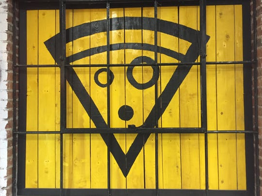 Black and vibrant yellow are the brand colors of the new Pizzava pizzeria in Midtown Reno.