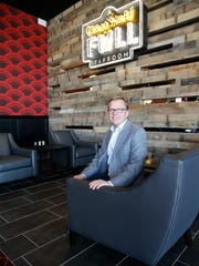 Neil Billinsley-Michaelsen, CEO and partner for Triple Tap Ventures, the Houston company with the El Paso franchise for the Alamo Drafthouse Cinema, sits outside the Glass Half Full bar in the new Alamo theater in West El Paso.