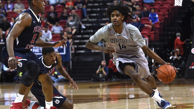 Nevada's Lindsey Drew brings the ball up court during a game against Fresno State in the Mountain West Tournament. He is the third member of his family to play in the NCAA Tournament.