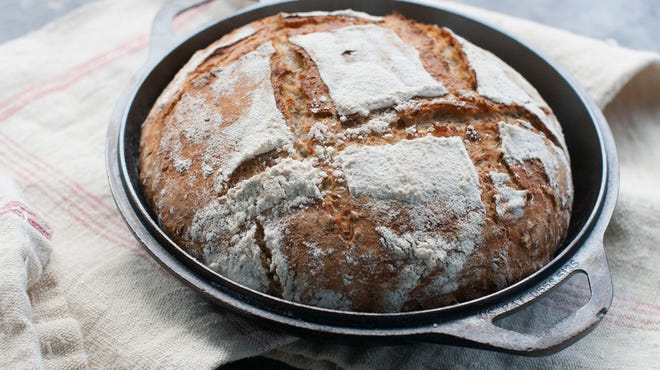 Dutch oven multigrain bread has a soft yet hearty interior texture and a deep golden brown crust.
