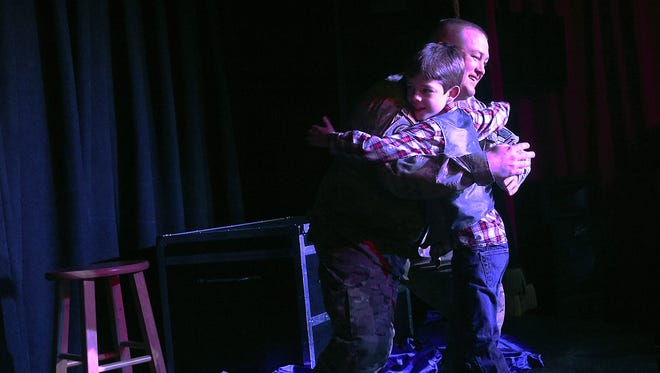 Nevada Army Guard 1st. Sgt. Ben Krainbrink surprises his son Drake during his birthday party at Impossible's Magic Shop in Reno after returning from serving in Kuwait and Iraq on Feb. 25, 2017.