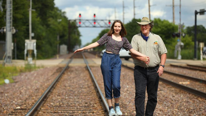 """Author Michael Comerford with his 15-year-old daughter, Grace Comerford, on July 31 in Barrington, Illinois. Michael wrote """"American Oz"""" about his year on the road with traveling carnivals."""