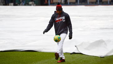 Indians starting pitcher Danny Salazar plays with a