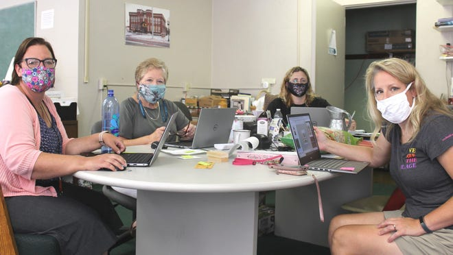 The staff of Coach Eby Center, Melissa Austin, Kathy Alger, Rachel Everett and Kristen Niedzwiecki, plan the details of their upcoming virtual banquet, online auction and donation opportunities.