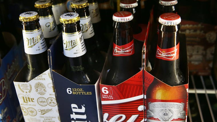 Bottles of Budweiser and Miller Lite beer are seen