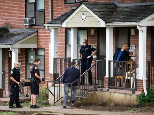 Police  and Detectives look around the area where 7-year-old Harmony Warfield was shot and killed by a 2-year-old at the J.C. Napier Homes in Nashville, Tenn., Tuesday, June 6, 2017.