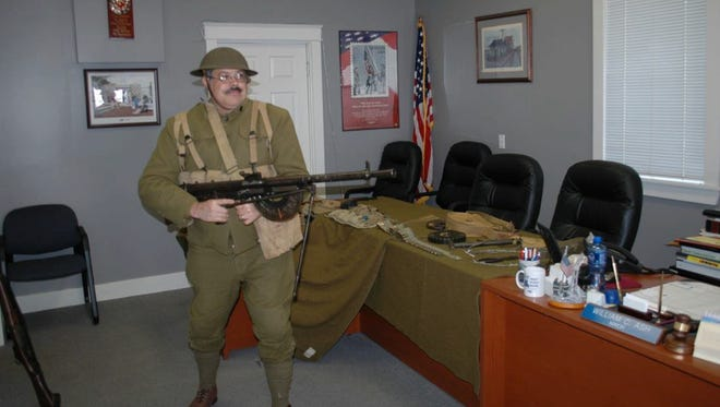 """Living historian"" Kevin Reid models a period-correct World War I uniform and weapon. He will speak this weekend in Henderson."
