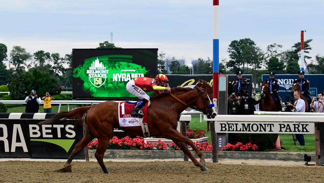 Mike Smith aboard Justify wins the 150th Belmont Stakes at Belmont Park.