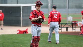Cincinnati Reds catcher Devin Mesoraco (39) get set for a bullpen session, Wednesday, Feb. 14, 2018, at the Cincinnati Reds Spring Training facility in Goodyear, Arizona.