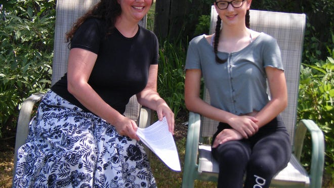 Elaine Miskinis and her daughter Hayden review her essay on dyslexia, a recent winner in the New York Times student editorial contest.