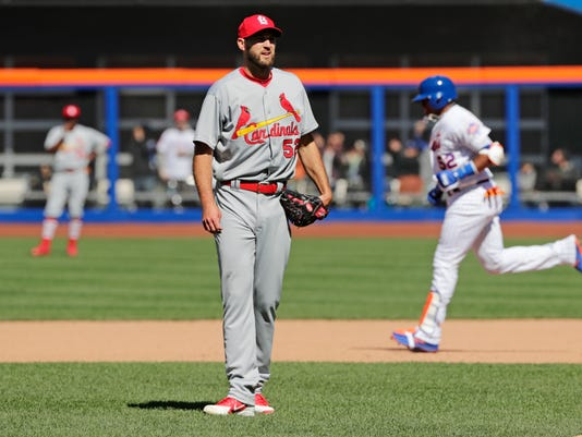 St. Louis Cardinals starting pitcher Michael Wacha (52) reacts as New York Mets' Yoenis Cespedes (52) runs the bases after hitting a home run in the fifth inning of a baseball game Saturday, March 31, 2018, in New York. (AP Photo/Frank Franklin II)