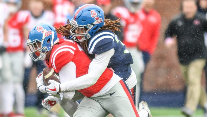 Ole Miss linebacker Josh Clarke (pictured making the tackle) emerged as a first-team linebacker this spring.