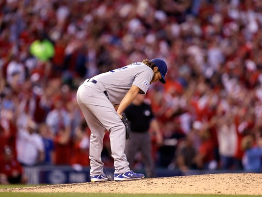 Los Angeles Dodgers starting pitcher Clayton Kershaw reacts after giving up a three-run home run to St. Louis Cardinals first baseman Matt Adams in the seventh inning of Game 4 of baseball's NL Division Series against the Los Angeles Dodgers, Tuesday, Oct. 7, 2014, in St. Louis.(AP Photo/Jeff Roberson)