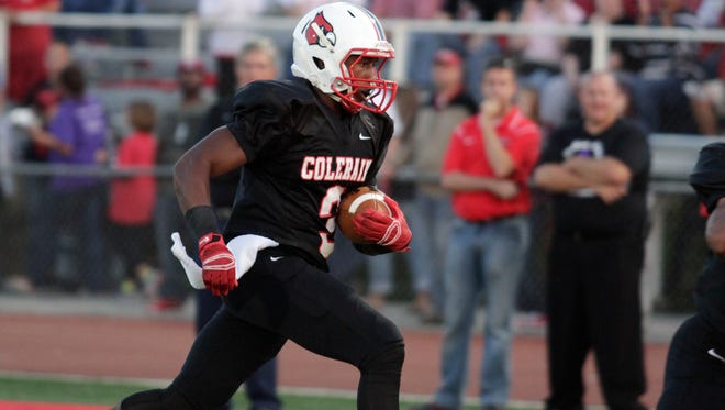 Colerain running back Jordan Asberry runs for a touchdown on the team's first possession.