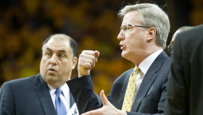 Iowa head coach Fran McCaffery disputes a foul call following a timeout during the Hawkeyes game against Wisconsin at Carver-Hawkeye Arena in Iowa City on Saturday, February 22, 2014. Benjamin Roberts / Iowa City Press-Citizen