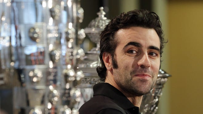 FILE - Dario Franchitti, the three-time Indianapolis 500 champion, talks about his decision to retire from racing Thursday during a news conference at Target Chip Ganassi Racing headquarters.