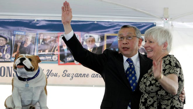Butler University President Bobby Fong and his wife Suzanne wave goodbye as they were celebrated Friday, May 13, 2011.  The Fongs are leaving the Butler University campus after a decade as president.  Danese Kenon/The Star