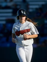 Voyagers bat girl Sarah Faulk hustles back to the dugout after collecting a foul ball behind home plate during Wednesday's game against the Orem Owlz.