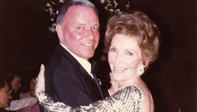 Frank Sinatra and Nancy Reagan dance together in this undated photo.