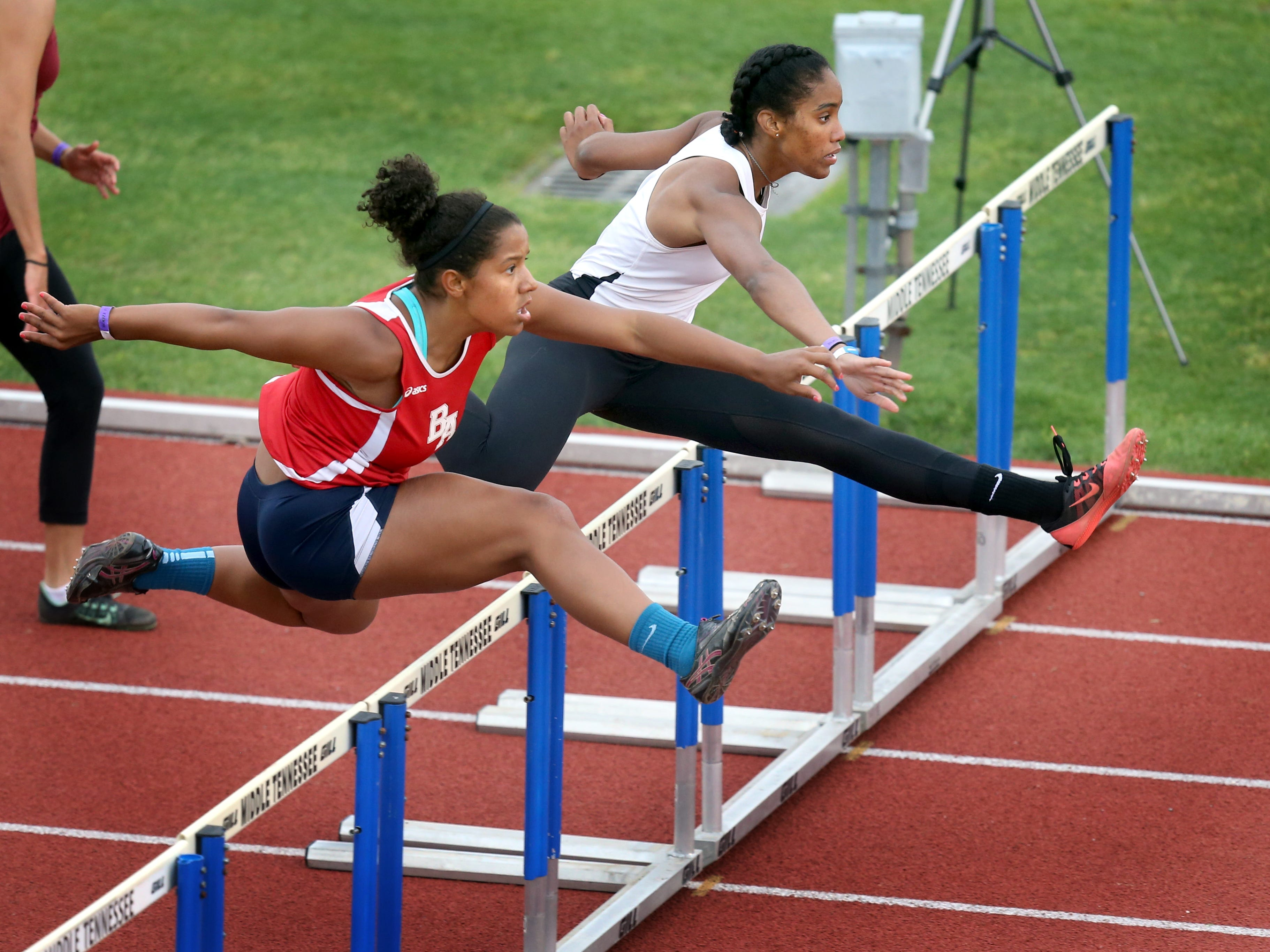 Ensworth's Tyra Gittens, right, won the DII 100-meter hurdles. Brentwood Academy's Jenna Langdon was second.