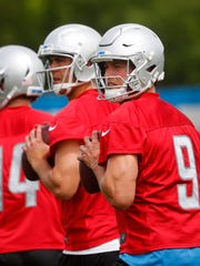 Detroit Lions quarterback Matthew Stafford, right,  and Matt Cassel, left, drop back during practice at the NFL football team's training camp in Allen Park, Mich., Tuesday, June 5, 2018.
