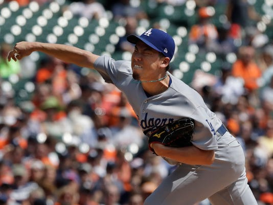 Los Angeles Dodgers starting pitcher Kenta Maeda throws during the second inning of a baseball game against the Detroit Tigers, Sunday, Aug. 20, 2017, in Detroit. (AP Photo/Carlos Osorio)