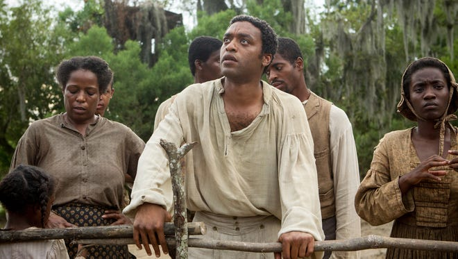 Chiwetel Ejiofor, center, received a best actor (drama) nomination for his portrayal of Solomon Northup in '12 Years A Slave.'