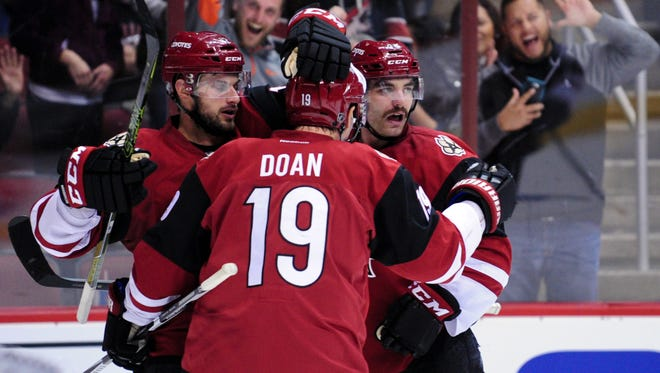 Dec 17, 2015: Arizona Coyotes left wing Jordan Martinook (48) celebrates with right wing Shane Doan (19) and center Brad Richardson (12) after scoring a goal in the second period against the Columbus Blue Jackets at Gila River Arena.