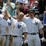 New York Yankees' Alex Rodriguez (13) is greeted by Brett Gardner, Mark Teixeira and Chase Headley after hitting a three-run home run.