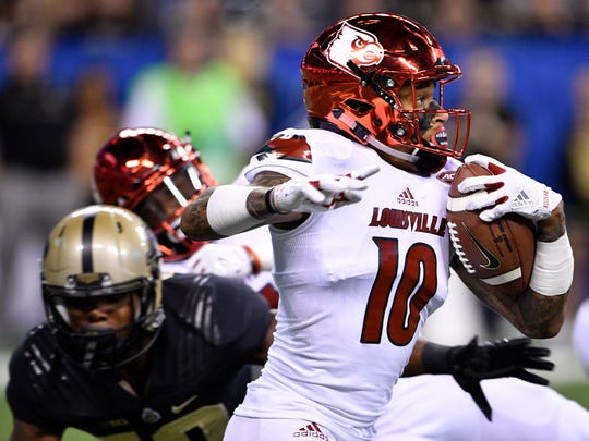Louisville Cardinals cornerback Jaire Alexander (10) runs the ball against Purdue Boilermakers cornerback Mike Little (10) during a punt return during the first quarter at Lucas Oil Stadium.