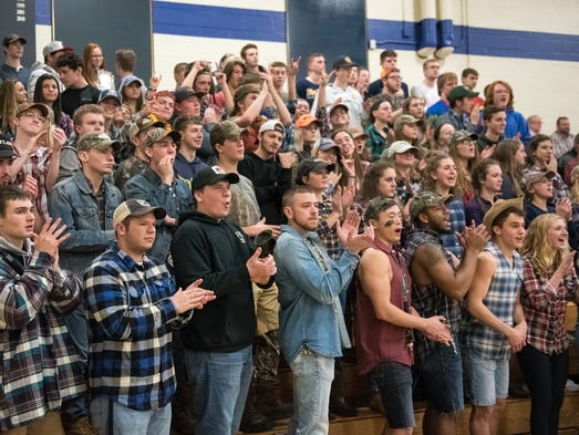 Greencastle's student section watches as Bryan Gembe