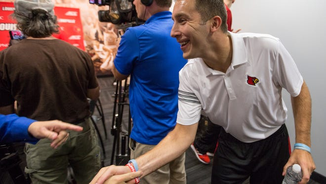 New University of Louisville assistant men's basketball coach Greg Paulus reached out to shake hands with a member of the media, after being introduced during a press conference. Oct. 19, 2017.