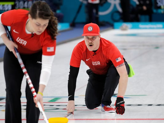 United States' Matt Hamilton, right, shouts instructions to his sister Becca during their mixed doubles curling match against Switzerland at the 2018 Winter Olympics in Gangneung, South Korea, Friday, Feb. 9, 2018. (AP Photo/Aaron Favila)
