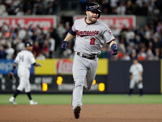 Minnesota Twins' Brian Dozier runs the bases after