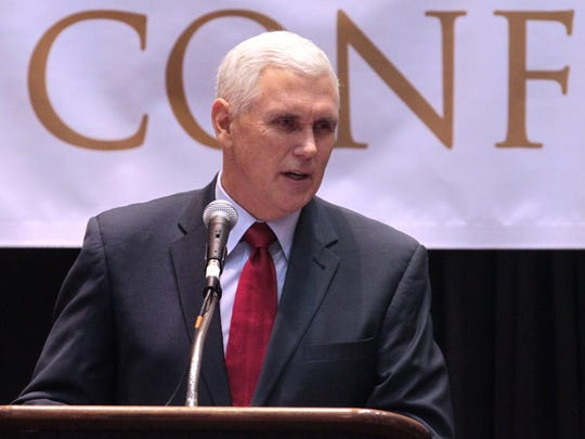 Gov. Mike Pence shares his 2014 legislative agenda at the Legislative Conference at the Indiana Convention Center in Indianapolis Thursday.