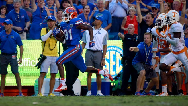 Florida receiver Antonio Callaway (81) runs the ball in for a 63-yard touchdown as the Gators rally to beat Tennessee.