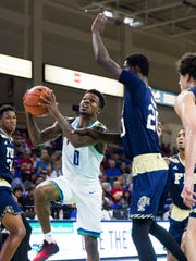 Florida Gulf Coast University junior, Brandon Goodwin,  shoots a layup during the game against Florida International University on Sunday, December 11, 2016 at Alico Arena in Estero, Fla.