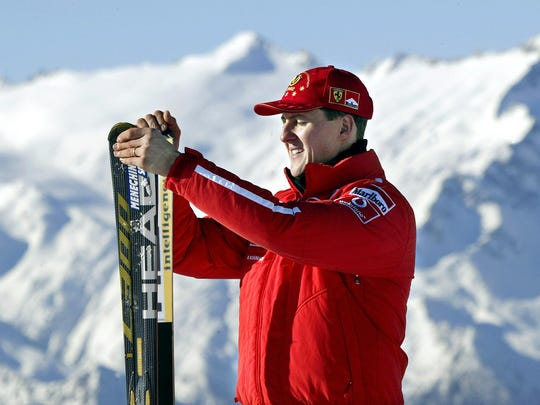 Michael Schumacher, holding his skis in Madonna di