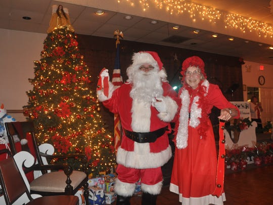 Santa and Mrs. Claus arrive for the festivities during