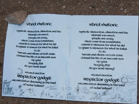 A poem is on the ground at the scene of the 2011 shooting