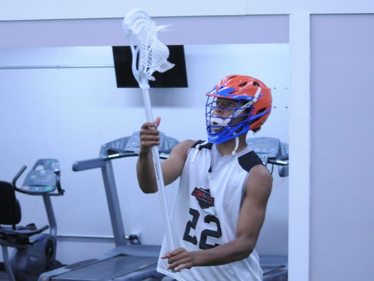 Dante Trader practices his lacrosse skills at Competitive
