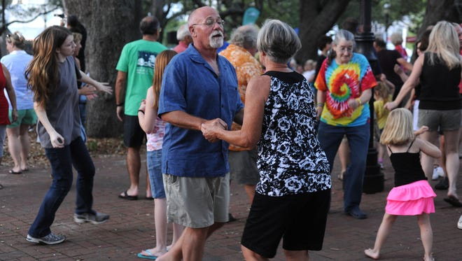 In this 2013 photo, people dance to Not Quite Fab on opening night of Evenings in Olde Seville Square.