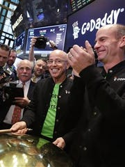 GoDaddy CEO Scott Wagner, pictured on the floor of the New York Stock Exchange during his time as CFO of GoDaddy, stepped down due to health reasons, the company said.